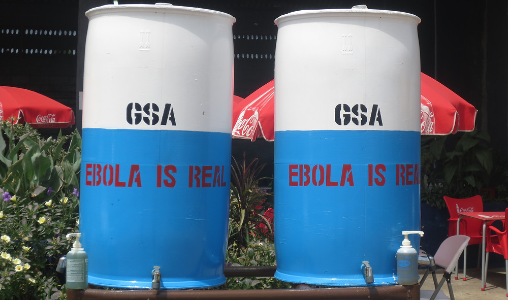 Hand-washing stations set up during the Ebola outbreak pictured outside of the General Services Administration, one of the USAID-GEMS supported agencies.