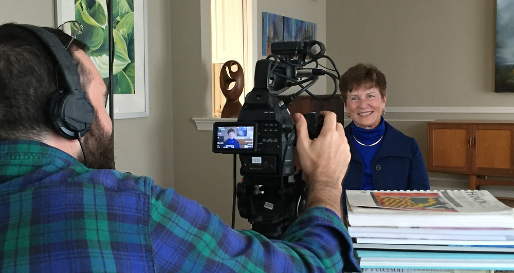 DDC's Jack Gordon gets ready for a take with IBI's Chairman Dr. Lucie Phillips.