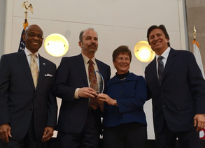 IBI Founder Dr. Lucie Phillips Accepts USAID Award, Shares Challenges Along the Way
