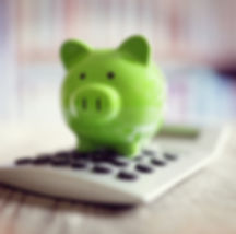 Piggy bank on calculator concept for saving, accounting, banking and business account.jpg