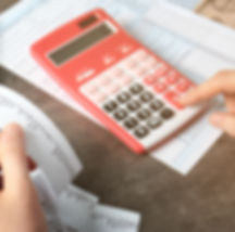 Man working with calculator and documents. Tax concept.jpg