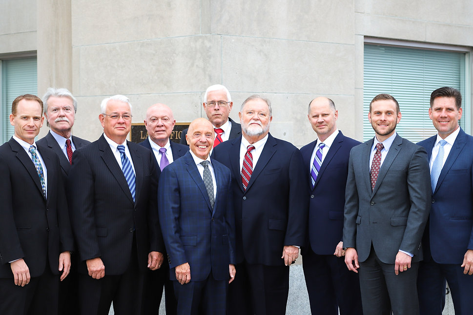 Withers Brant Firm standing in front of their law office