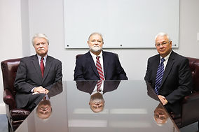 Lawyers sitting around a glass table