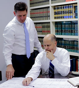 Lawyers deliberating over a document
