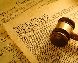 Wooden mallet resting on the US constitution