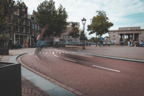Fietsers over het Haarlemmerplein
