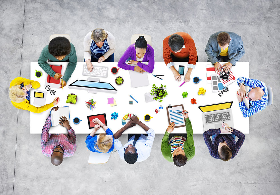 looking down on desk with people working