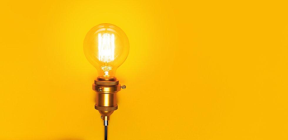 lightbulb-yellow-background-narrow-tall.