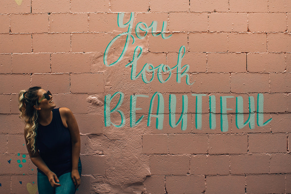 Canva - Woman Standing in Beige Concrete Block With You Look Beautiful Paint.jpg
