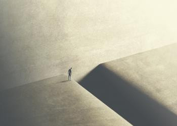 an image of a small silhouette is staring down a cliff