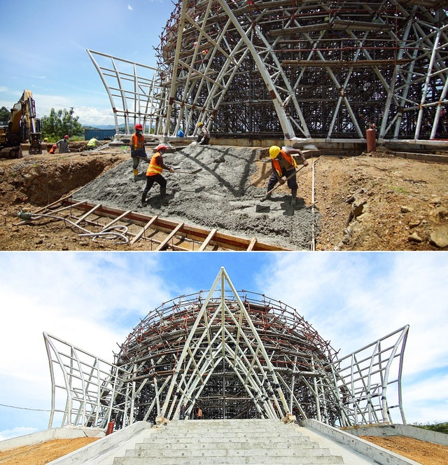 an image of the temple after the basic structure is built with the concrete being poured and spread it