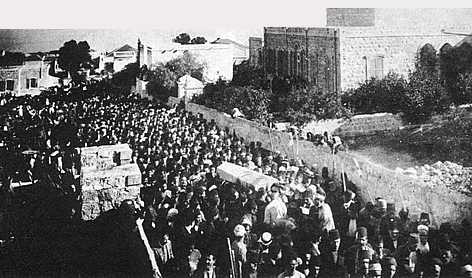 The casket being carried to the Shrine of the Bab.