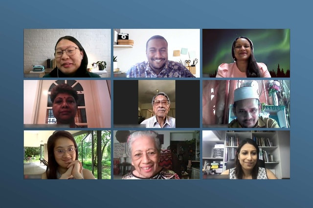 9 people are shown, they appear to be in a zoom call, and all of them are smiling