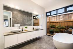 Modern bathroom with stone bathtub