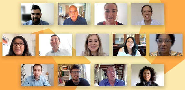 13 people are shown smiling and seem to be in a zoom call, they are all diverse and are people from different backgrounds