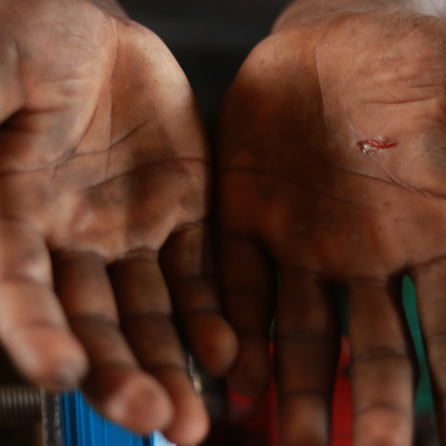 HANDS OF THE WORKERS WHEN NOT USING ANY TOOLS TO WRAP FLAT WIRES