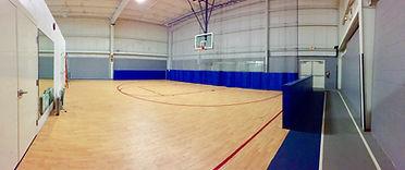Half-court basketball gymnasium