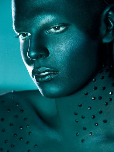 Black bodypaint with blue lighting