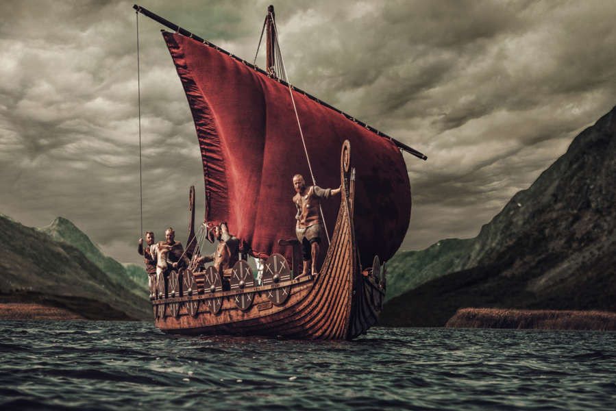 Viking ship ploughing through the cold waters of the North Atlantic ocean
