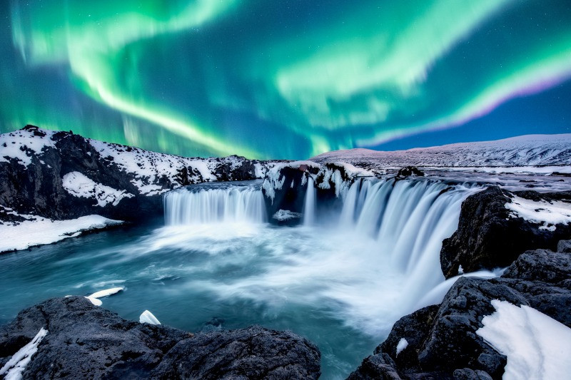 Northern Lights over Godafoss during Iceland in the winter