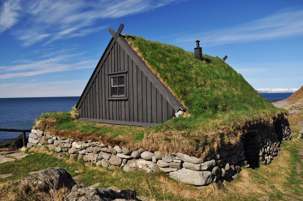 Traditional turf house in Iceland by the coast