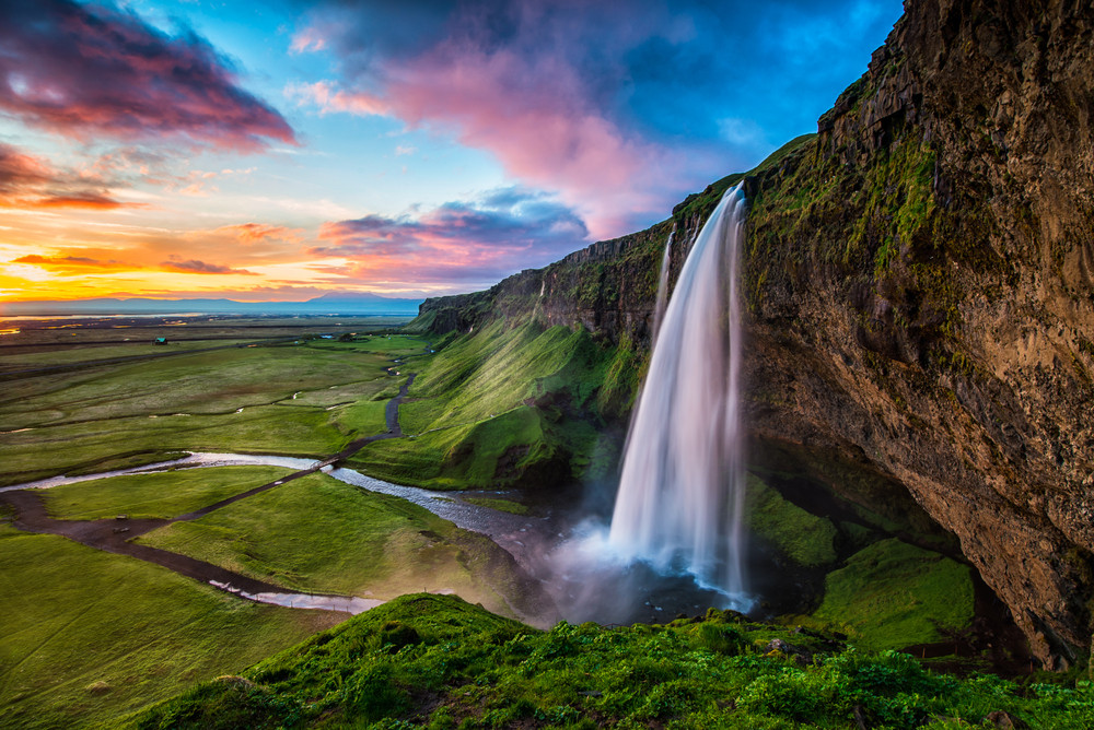 You can discover amazing waterfalls as the one in the picture with a day tour from Reykjavik