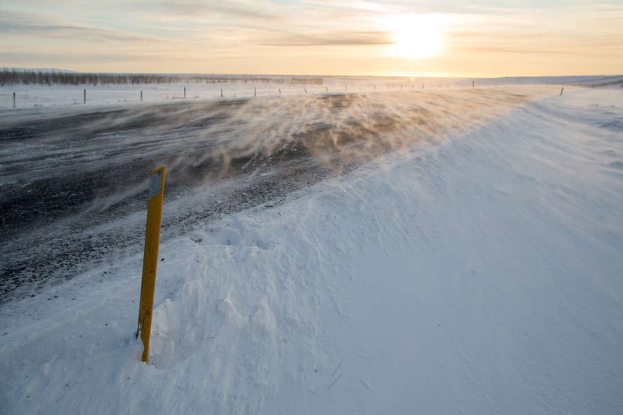 Wind in Iceland on the snowy surface of a frozen road
