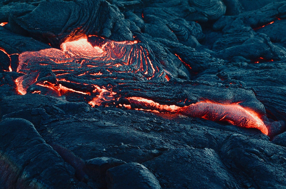 Lava flowing out of a volcano in Iceland and getting solidified