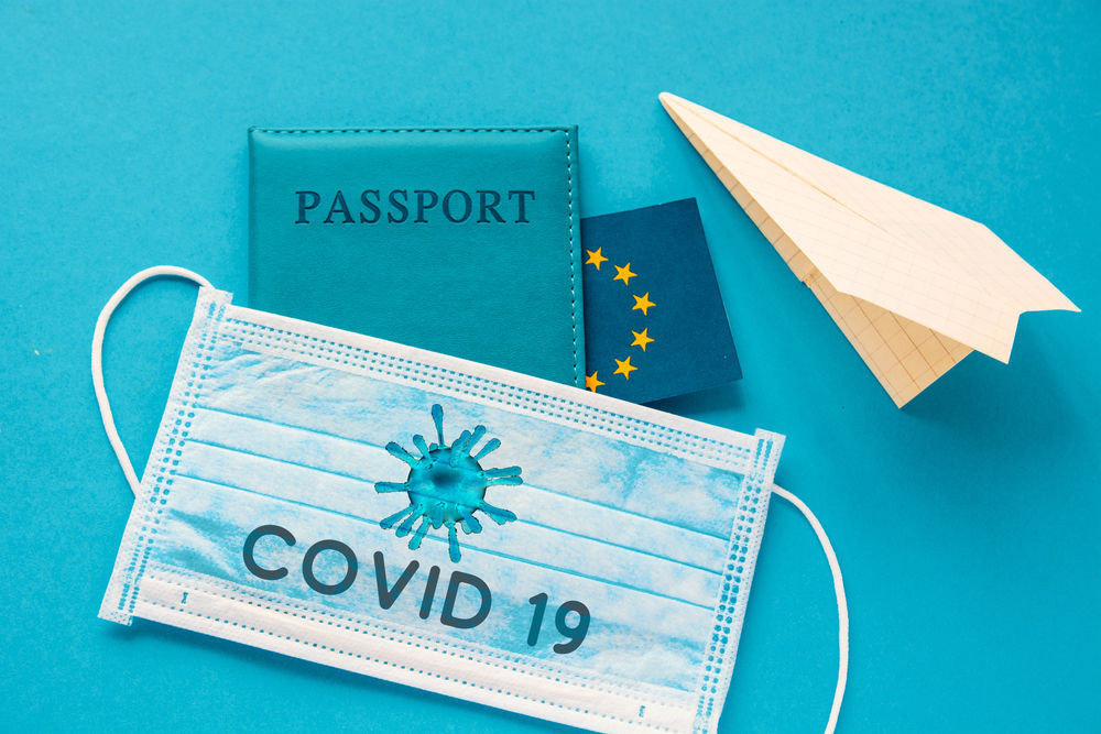 Passport and covid mask as in traveling during the pandemic