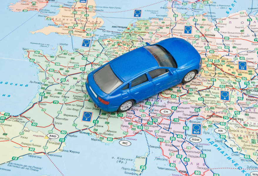 Toy car on a map of Europe - driving in Europe