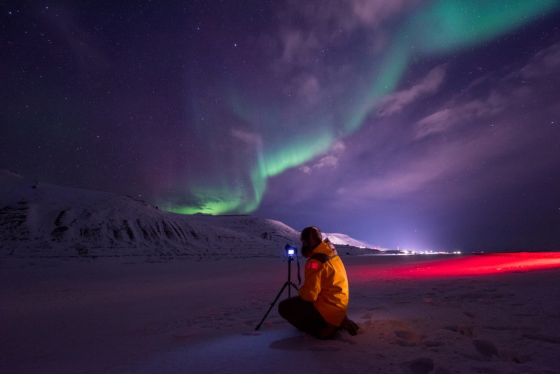 photographer hunting for the northern lights in Iceland