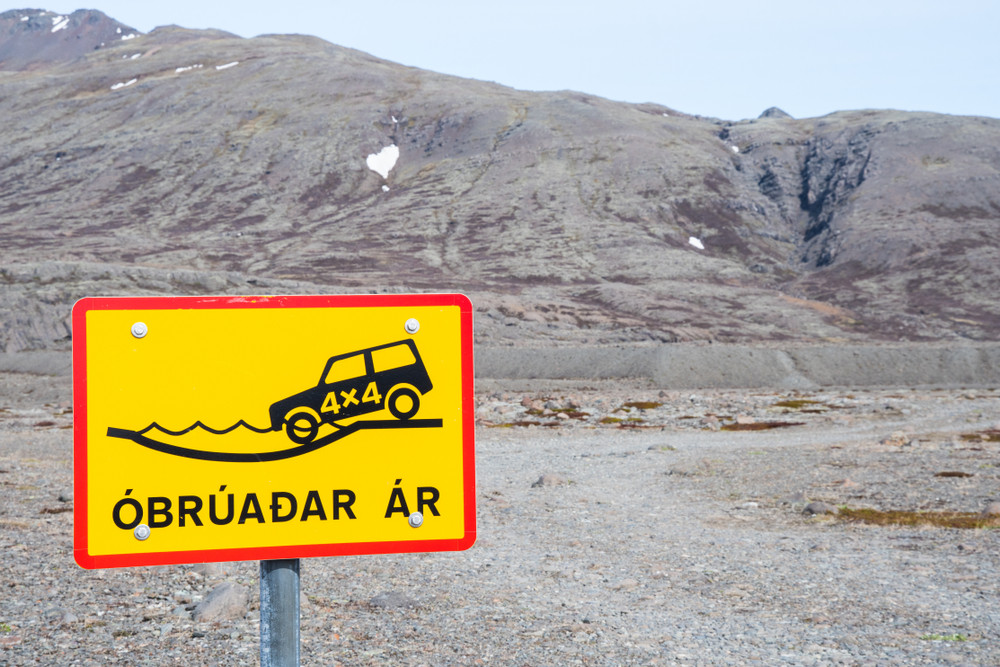 Iceland road sign showing that a 4x4 vehicle is mandatory for fording rivers