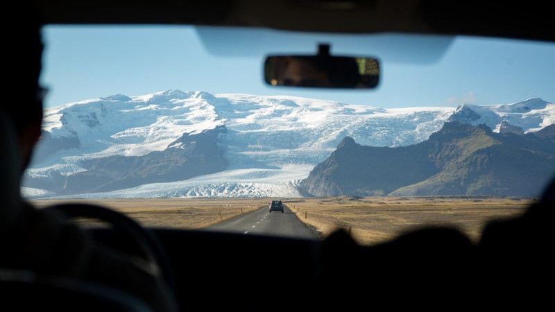 Driving in Iceland on the Ring Road with beautiful views on the background