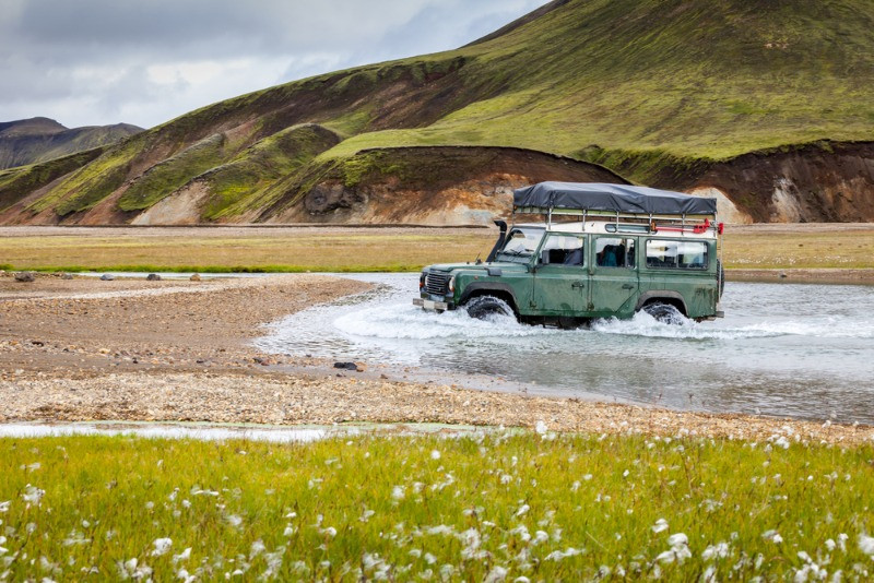 jeep crossing a river in Iceland