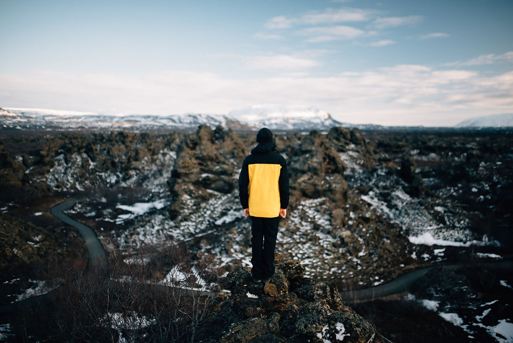 tourist standing in front of the Dimmuborgir lava field