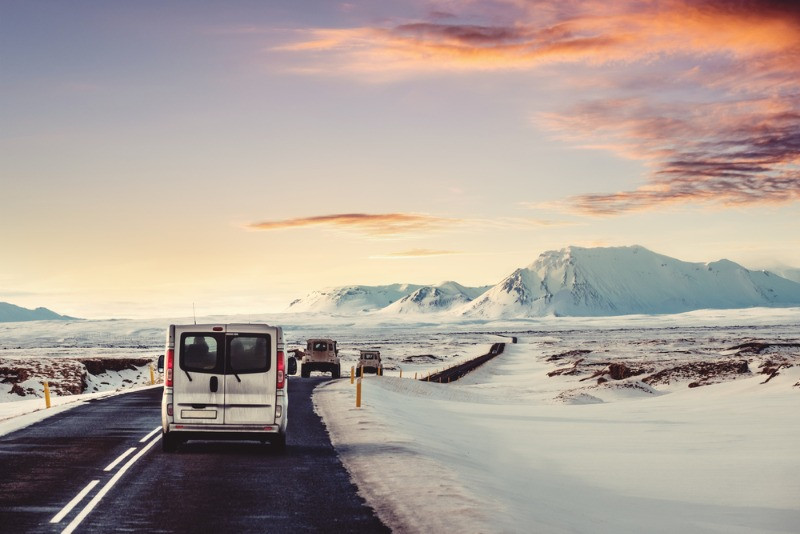 Camper driving in winter in iceland with a beautiful snowy landscape