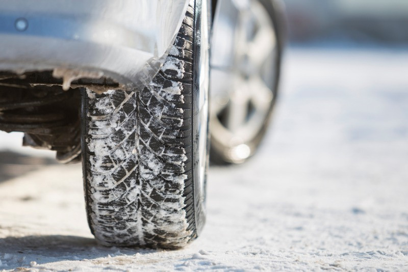 Up close image of a car with winter tires in Iceland