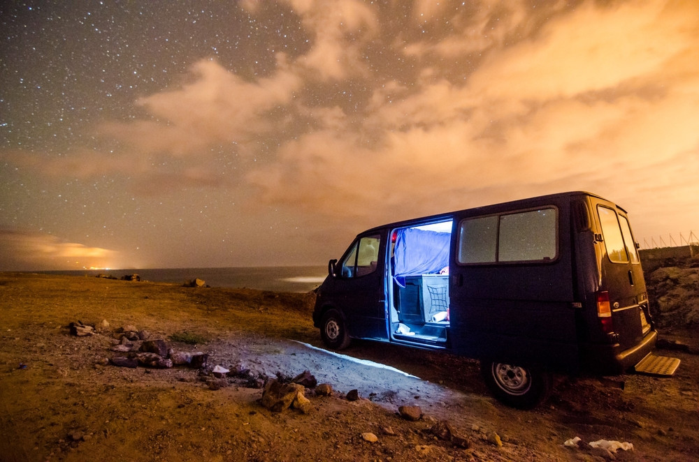 Camper parked under the light of the stars. Renting a camper is a great option to make camping easy in Iceland