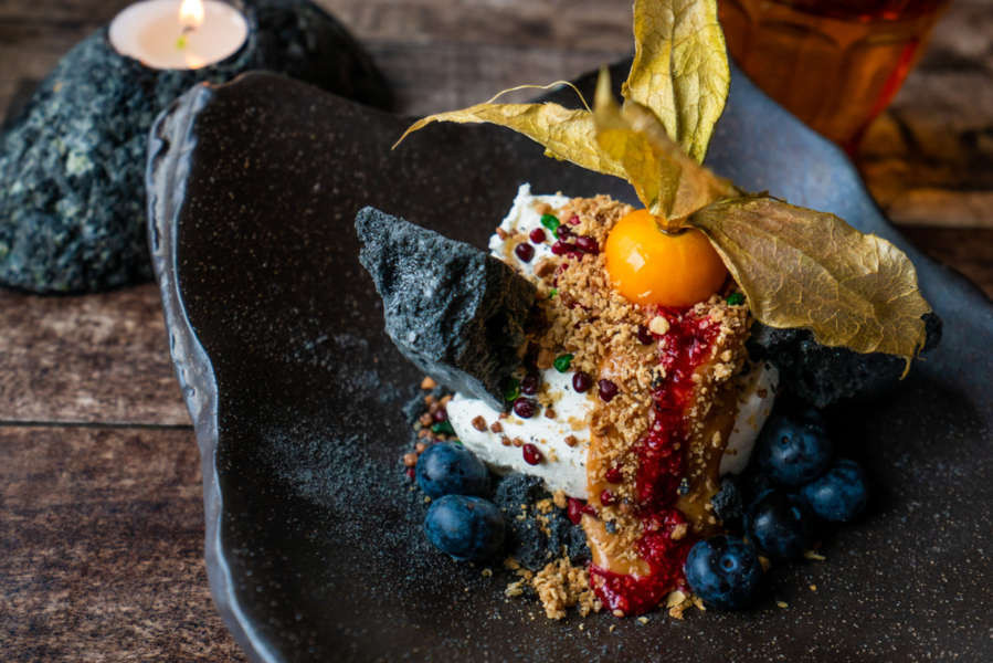 Icelandic ice cream with lava rock and fruits
