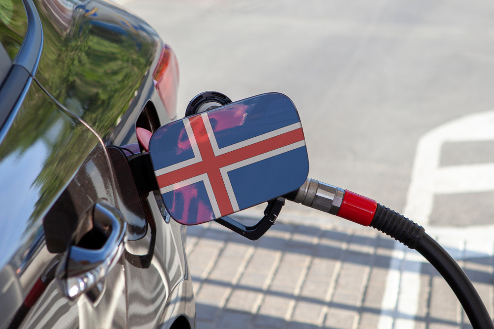 Car fueling up with the flag of Iceland on the nozzle - Gas prices in Iceland