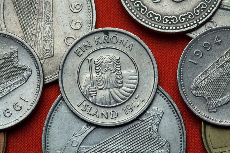 One krona coin and other icelandic currency