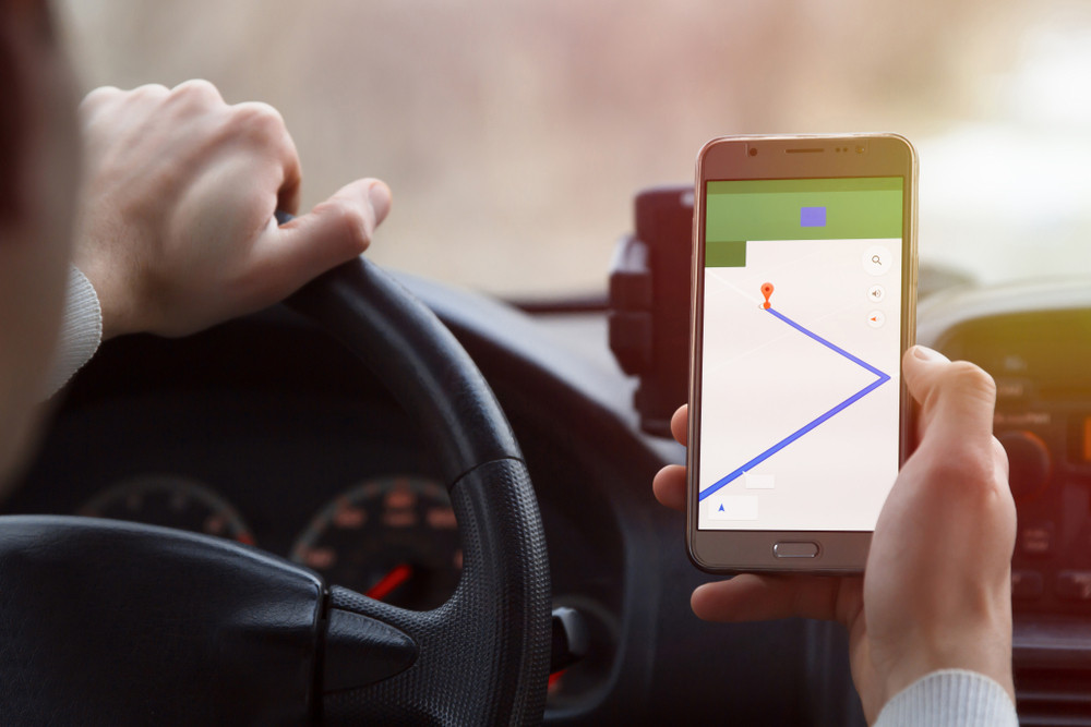 man using google maps in Iceland while driving