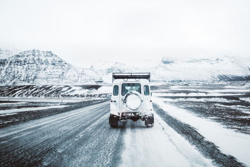 Jeep driving through the highlands with the best insurance option in Iceland added
