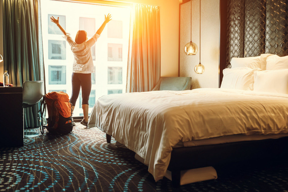young woman enjoying her hostel room - best hostels in Iceland