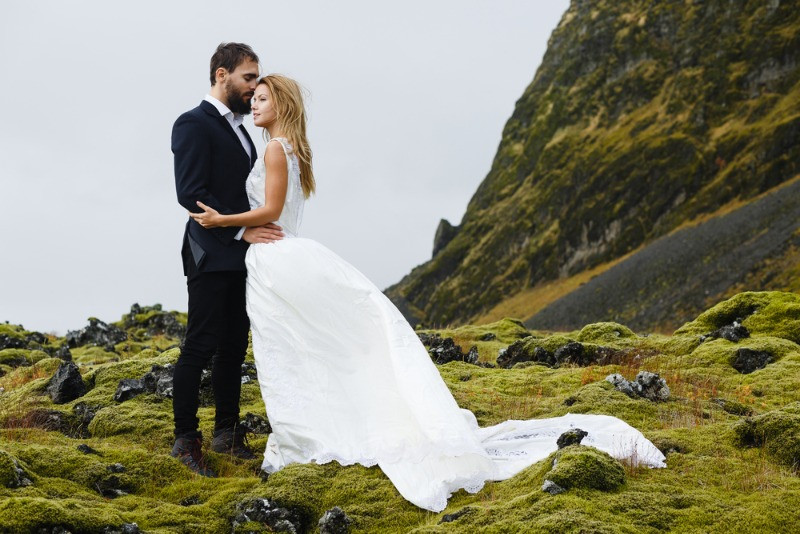 Couple of new wed on the moss ground of Iceland