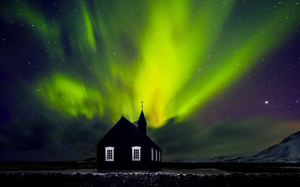 Northern lights over an Icelandic church