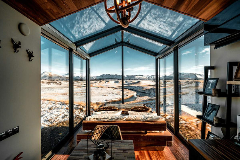 Panoramic hotel in Iceland with a wide window overlooking the majestic landscape