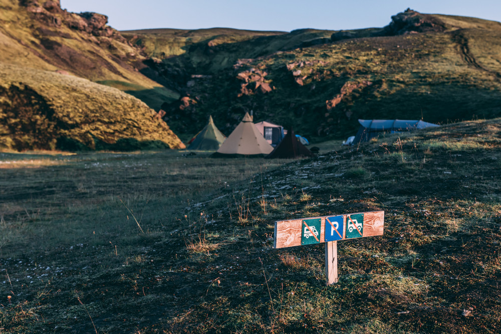 Campers by a prohibition of car and RV's parking. Right to roam in Iceland.