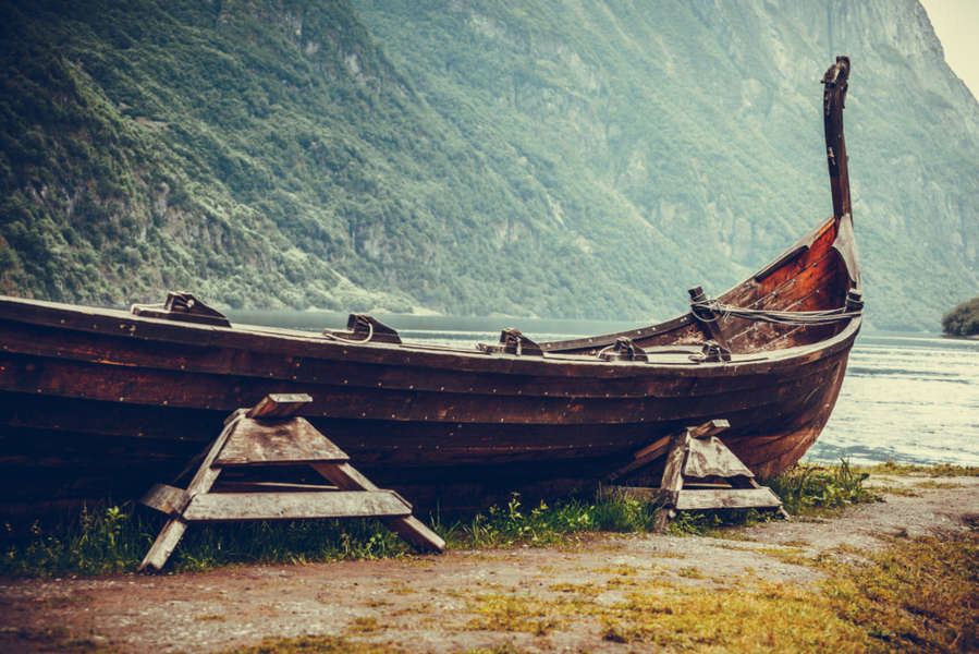 Replica of a viking ship by the fjords coast line