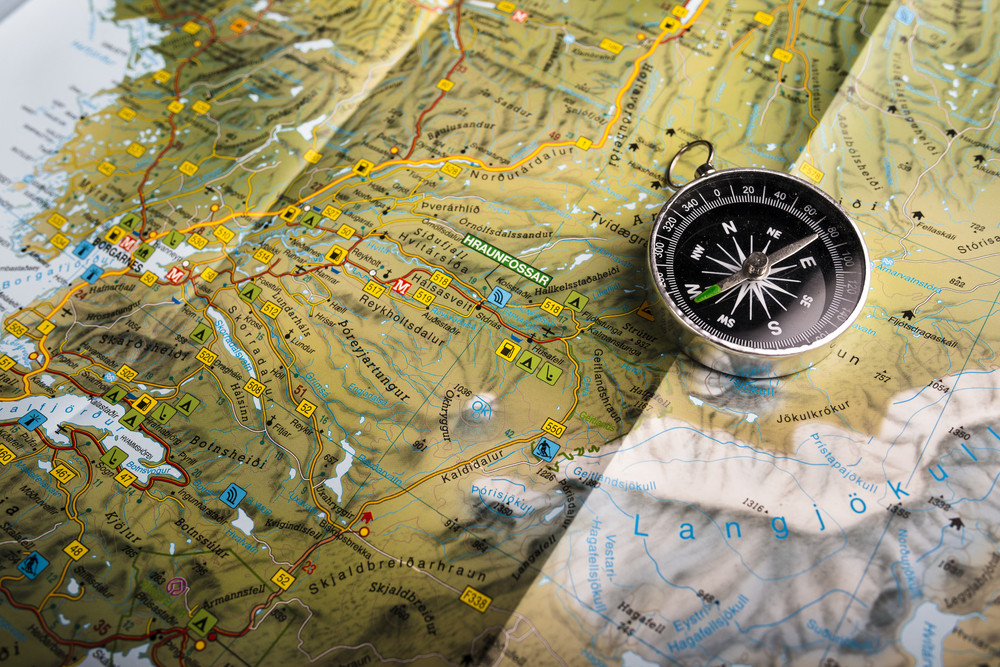 compass  on an icelandic map, iceland clockwise or counterclockwise